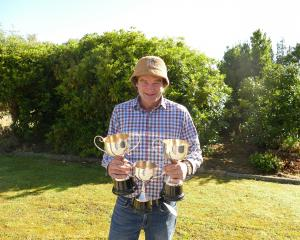 Blair Robertson displays his Romney trophies. Photos: Ken Muir