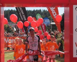 Braden Currie, of Wanaka, crosses the finish line. Photos: Mark Price