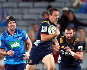Highlanders co-captain Ben Smith looks to tear up the field as hooker Liam Coltman (right) comes...
