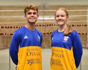 University of Otago Football Club players Oban Hawkins and Erin Roxburgh show off the 150th...