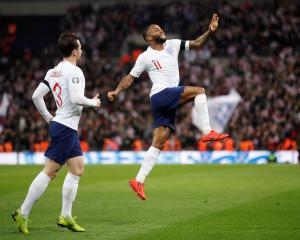 England forward Raheem Sterling celebrates scoring his third goal during a demolition job against...