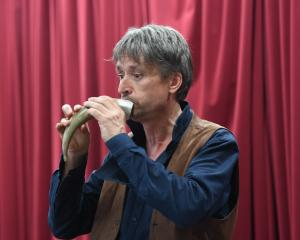 Recorder virtuoso Piers Adams performs for pupils at St Clair School yesterday, on an ancient...