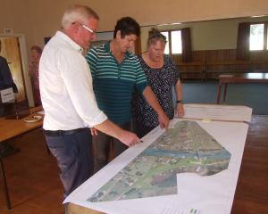 Beaumont residents inspect design plans for the new Beaumont bridge. Photo: Adam Burns