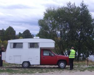 Ricky Campbell approaches a camper during freedom camping checks at Lowburn. PHOTO: ADAM BURNS