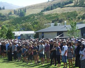 Central Otago residents gather together in Clyde yesterday to show solidarity after Friday's...