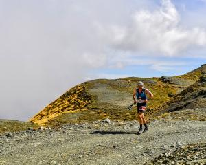 Dunedin's Chris Bisley is all smiles over the hills during the weekend's Northburn 100. PHOTO:...