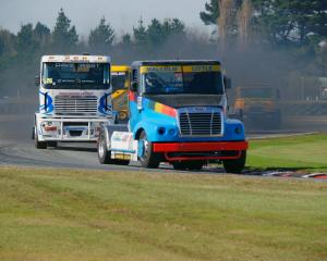Alex Little leads Troy Wheeler round the bend in his freightliner during the New Zealand Super...