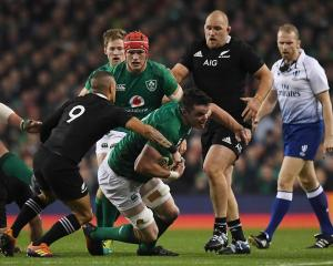 Ireland's James Ryan gets tackled by All Black Aaron Smith. Photo: Reuters