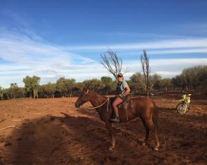 Central Otago vet Amy Watts has been mustering in Australia both on horseback and motorbike. 