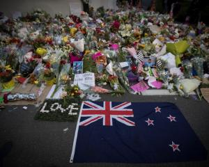 Flowers placed in tribute to the victims on a wall outside the Al Noor mosque in Christchurch....