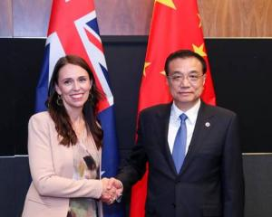 Jacinda Ardern and Chinese Premier Li Keqiang at the Asean Summit in November in Singapore. Photo...