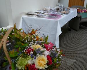 Home baking and flowers provided by South Otago community members for Muslim mourners attending a...