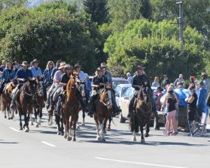 Cavalcade participants parade through Lake Hawea township today. Photo: Mark Price