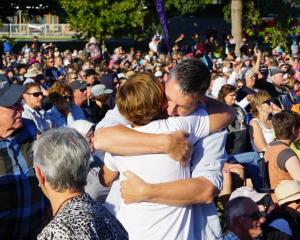 People embrace during a vigil in Hagley Park, Christchurch. Photo: RNZ