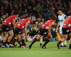 Finlay Christie clears the ball from a Hurricanes ruck as the Crusaders defensive line makes its...