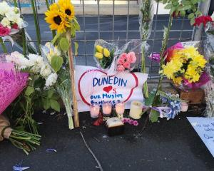 Tributes outside the Al Huda Mosque in Dunedin. Photo: Vaughan Elder