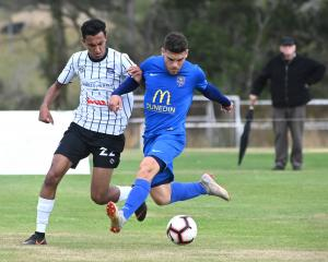Hawke's Bay United's Karan Mandair and Southern United's Abdulla Al-Kalisy compete for the ball...