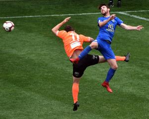 Southern United Garbhan Coughlan heads the ball during his hat-trick game against Hamilton...