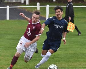 Dunedin Technical's Rhys Quarrell (left) and Southland United's Angel Alberto Garcia dispute...