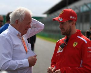 Charlie Whiting talks to Sebastian Vettel yesterday ahead of the season-opening Australian Grand...