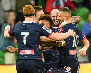 Rebels players celebrate their win over the Brumbies. Photo: Getty