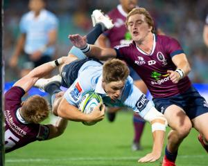 Alex Newsome dives across to score for the Waratahs. Photo: Getty
