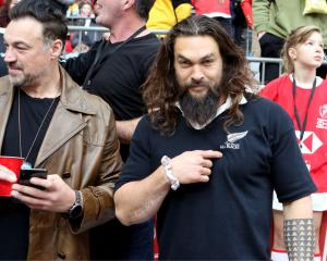 Jason Momoa wears his All Blacks jersey on the sidelines at the Vancouver Sevens. Photo: Getty