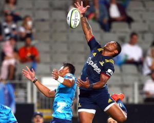 Highlanders winger Waisake Naholo (right) and Blues fullback Melani Nanai look to capture the...