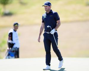 Josh Geary walks down the first fairway during the final round of the New Zealand Open at The...