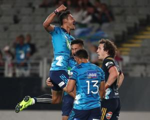 Melani Nanai celebrates a Blues try with Rieko Ioane and TJ Faiane during their win over the...
