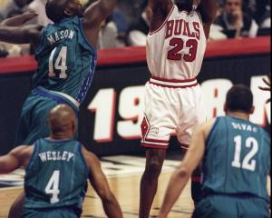 Chicago Bulls guard Michael Jordan shoots a mid-range jump shot against the Charlotte Hornets as...