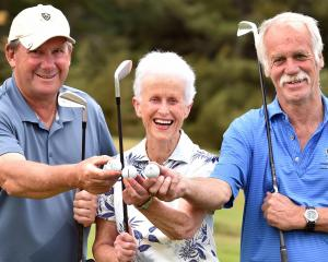 Celebrating their talents in each scoring a hole in one at the Otago Golf Club's Balmacewen...