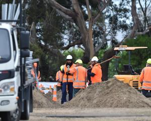 Heavy machinery is being used for the preparation of graves. Photo: Gregor Richardson