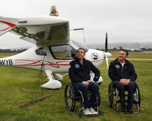 Handiflight pilots Alex Krol (left) and Eric Dabas in front of the German-built CTLS light sport...