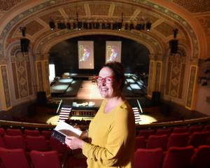 iD Dunedin Fashion Week spokeswoman Nicola McConnell flicks through an event programme at the...