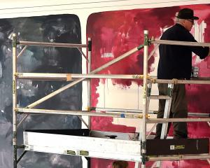 "John Reynolds works on underpainting the ""big wall"" at the Dunedin Public Art Gallery. Photo: Peter McIntosh"