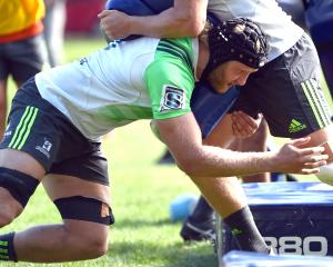 Highlanders lock Josh Dickson makes a tackle during a training session at Logan Park yesterday....