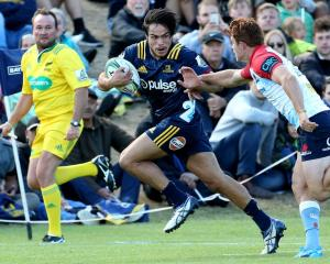 Josh Timu on the run for the Highlanders, who he has been training with, in a preseason match...