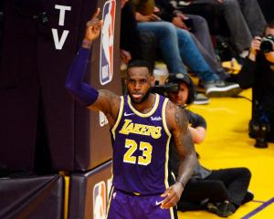 LeBron James celebrates after moving past Michael Jordan into fourth on the all-time NBA scoring...