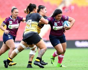 Liz Patu on the run for Queensland during Saturday's Super W match against Western Australia....