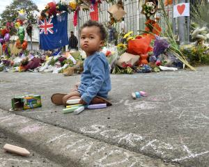 Ivy Roux Fawehinmi (18 months), of Dunedin, sits outside the Al Huda  mosque, in Dunedin's Clyde...