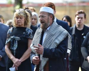 Dunedin Multi-Ethnic Council president Paul Gourlie speaks near the Peace Pole in the Otago...