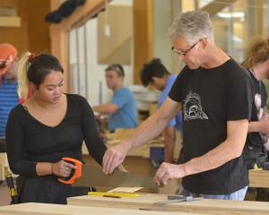 Otago Polytechnic lecturer Alan Fraser helps construction trade skills carpentry student Susha...