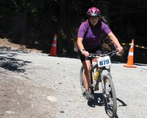 IMG 3932: Rachel Lindsay of Holy Fit Team racing to the transition tent to check in. Photo: Julie...
