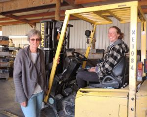 Julie Watt checks in with her eldest daughter, Irene Passadore, in the packing shed. Photo: Sally...