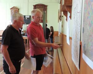 Noslam co-ordinator Rob McTague (left) and chairman Peter Mitchell discuss the map showing where...