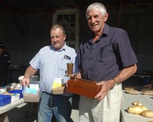 Lindsay Green (right), in the seeds shed with Temuka farmer Warren Stratford, at the recent...