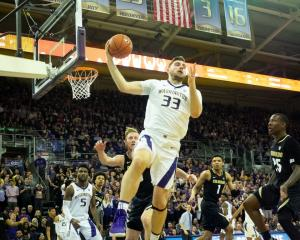 Sam Timmins pulls in a rebound for Washington against Colorado during the Pac-12 tournament last...