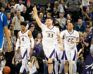 Sam Timmins celebrates during Washington's win over UCLA earlier this year alongside Matisse...