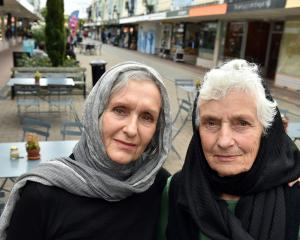 Alison Gilmore (left) and Caroline Maze wear headscarves in Christchurch yesterday afternoon, to...